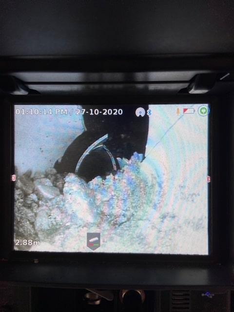 CCTV camera view of damaged and blocked drain Brisbane.