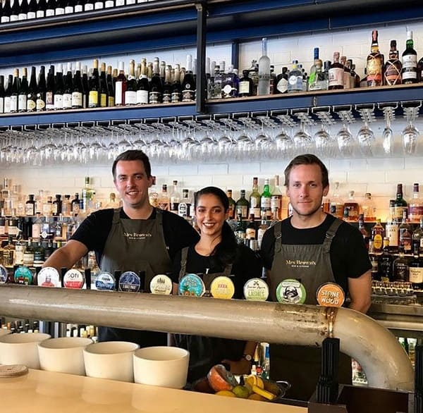 Mrs Brown's Bar and Kitchen staff standing behind the bar